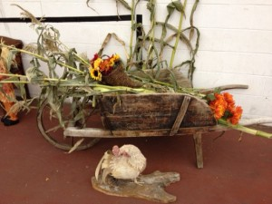 Beautiful antique wheelbarrow and a hand crafted rooster